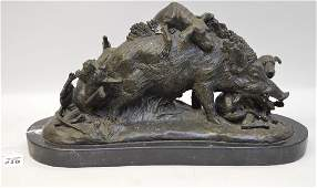 BRONZE SCULPTURE depicting a large boar fighting three