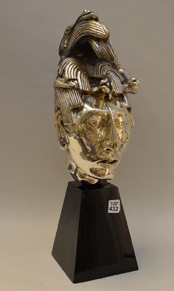 Large Mexican Sterling Bust on a black lacquer base.