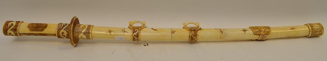 Carved & Etched Bone Sword & Sheath.  Condition: good
