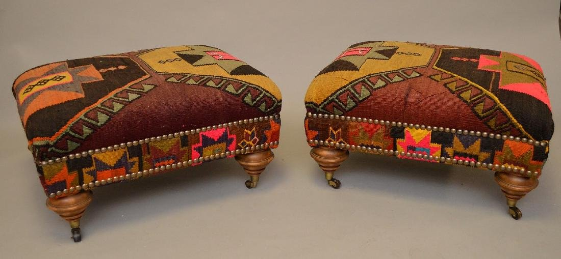 Pair of ottomans in multi color flat weave upholstery,