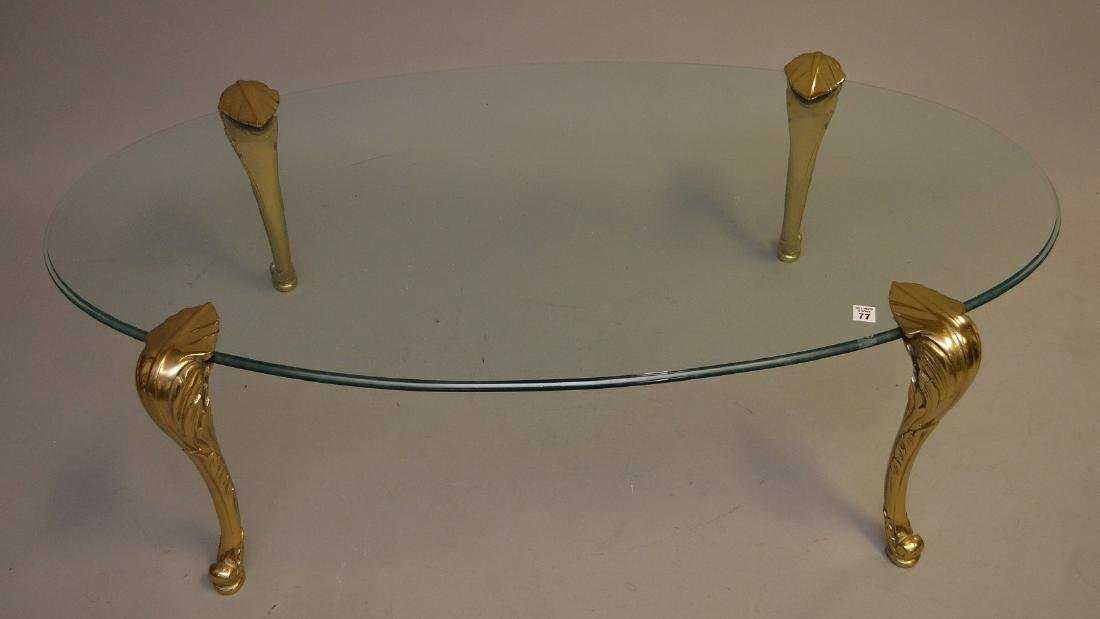 Oval glass top coffee table with brass cabriole legs, - 2