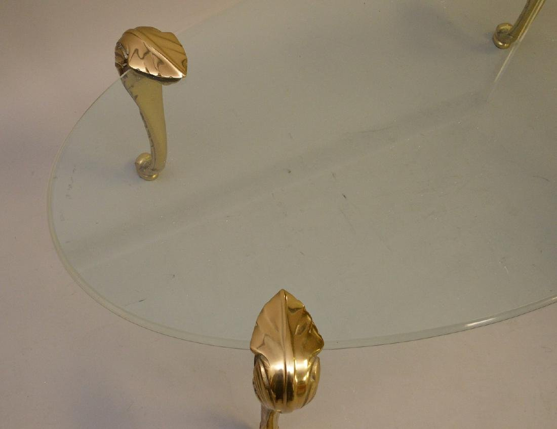 Oval glass top coffee table with brass cabriole legs, - 4