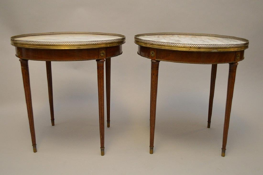 Pair of marble top occasional tables with pierced brass
