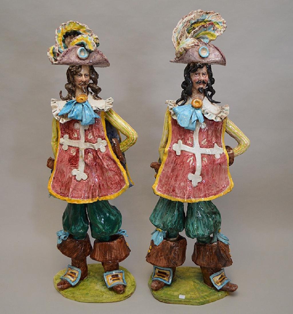 "Pair of ceramic Italian Musketeers, 49""h x 17""w"