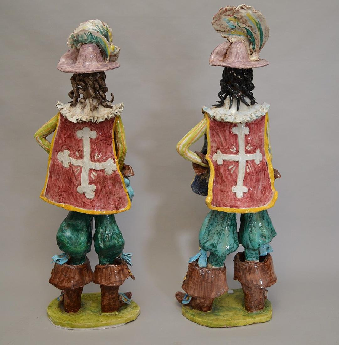 "Pair of ceramic Italian Musketeers, 49""h x 17""w - 7"