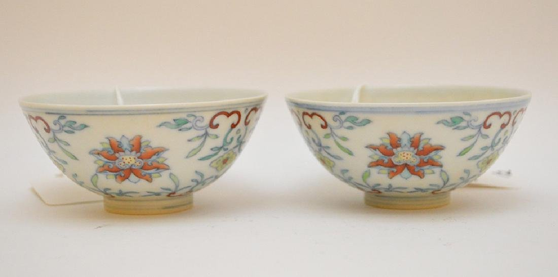 PAIR OF CHINESE PORCELAIN TEA BOWLS - Featuring a lotus