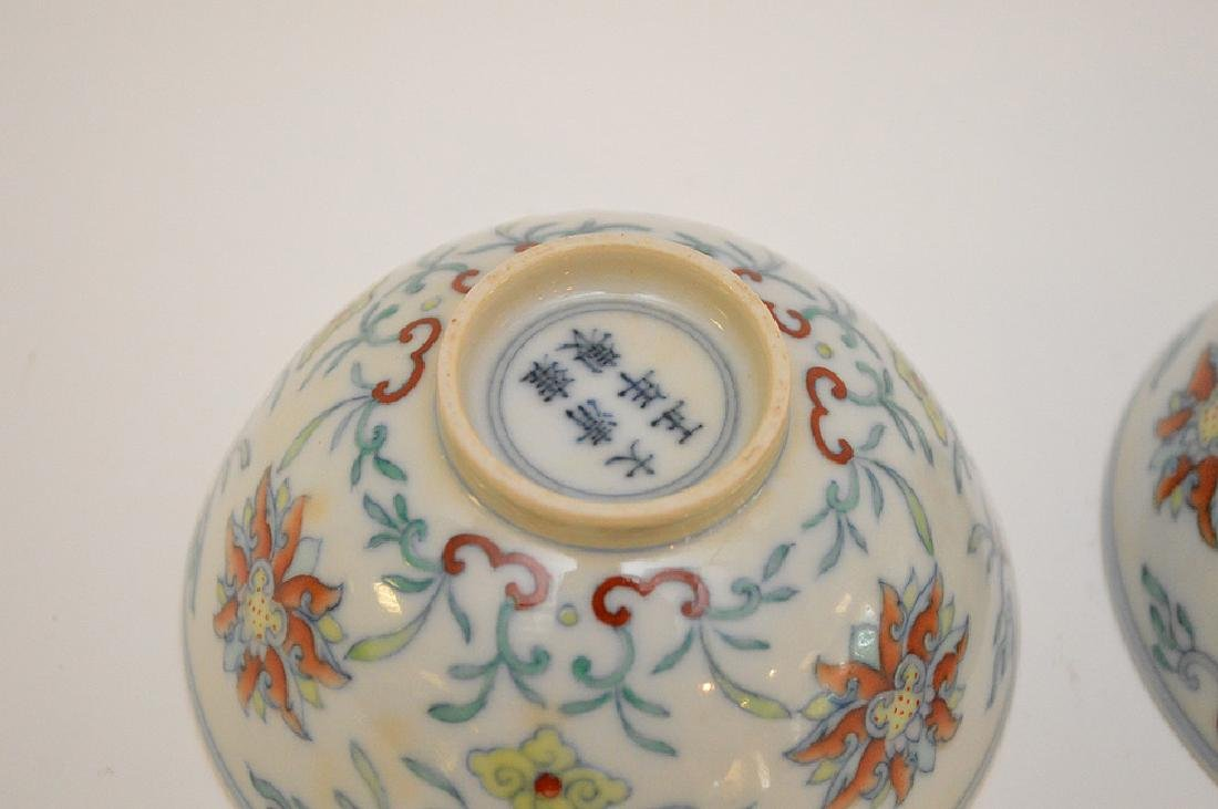 PAIR OF CHINESE PORCELAIN TEA BOWLS - Featuring a lotus - 4