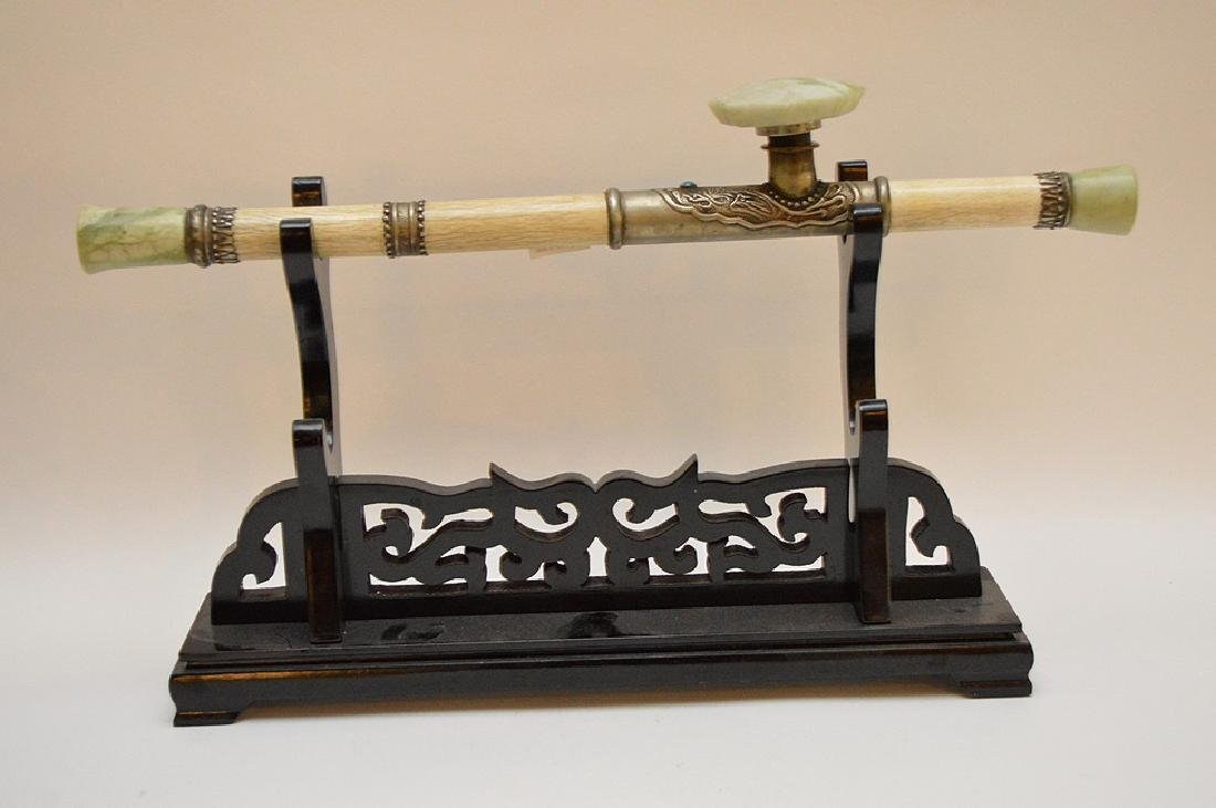 """Chinese bone pipe on wood stand, 18""""L"""