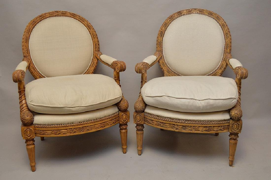 Pair carved & upholstered arm chairs