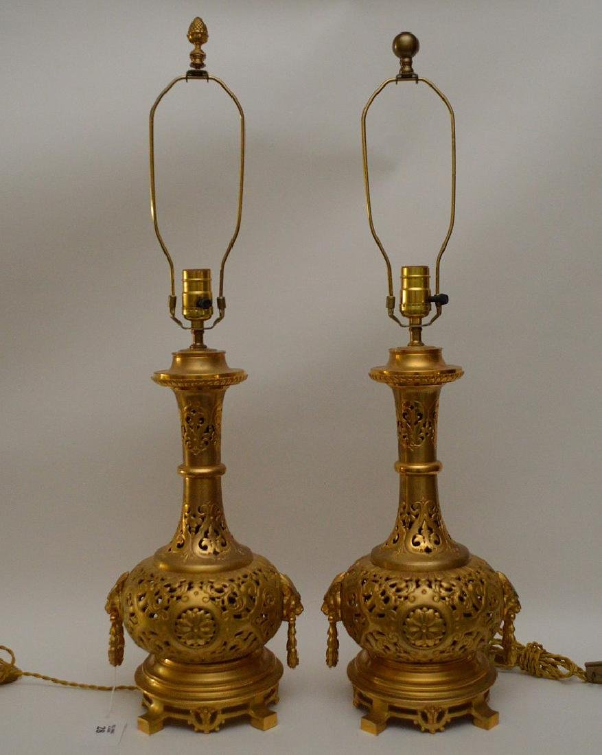 Pair Dore bronze reticulated lamps with lion ring