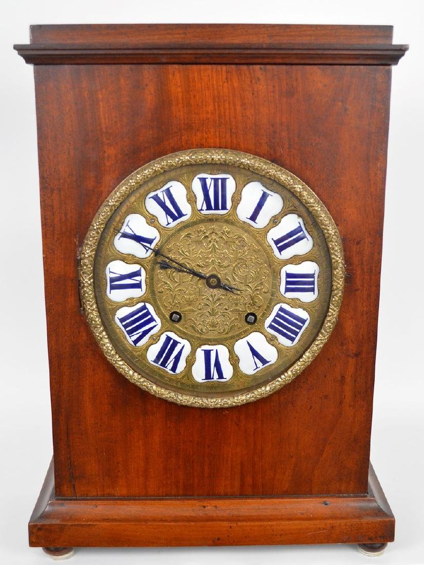 18th c. mahogany mantle clock with brass & porcelain
