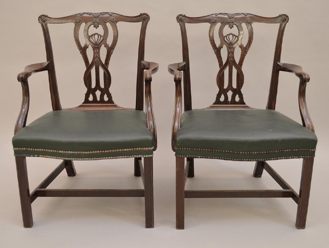 "Pair 19th c. carved mahogany arm chairs, 37""h x 28""w x"