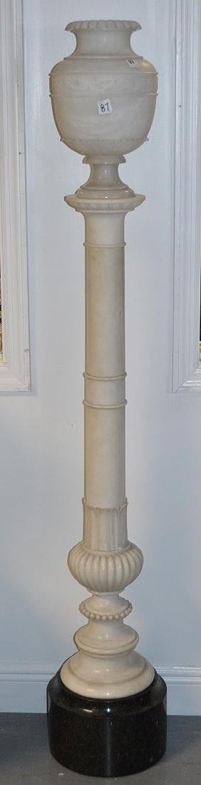 White carved marble pedestal, series of rings with