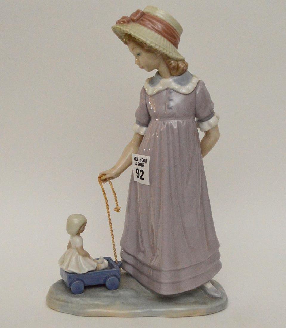 "Lladro tall girl pulling wagon, 10 1/2""h"