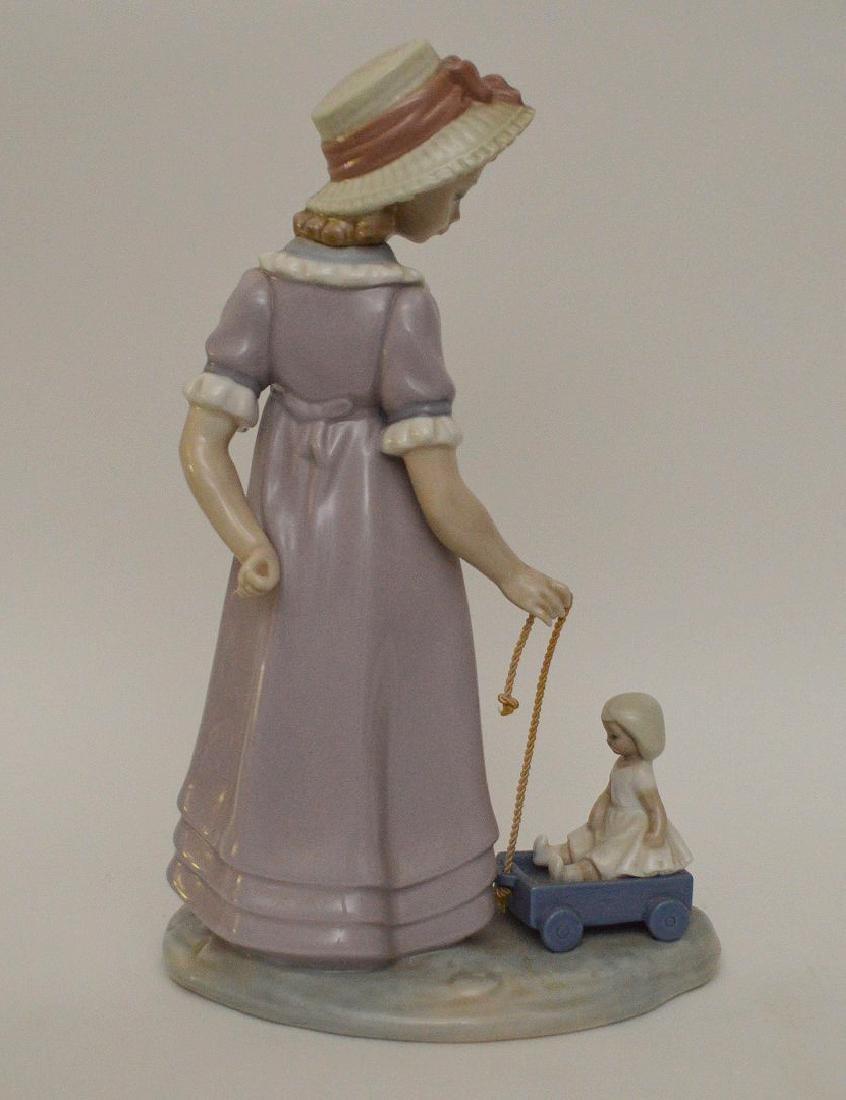 "Lladro tall girl pulling wagon, 10 1/2""h - 3"