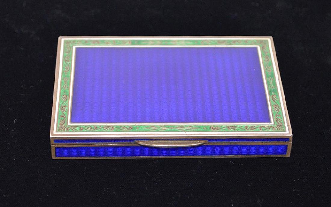 Enamel on silver cigarette box, blue guilloche field