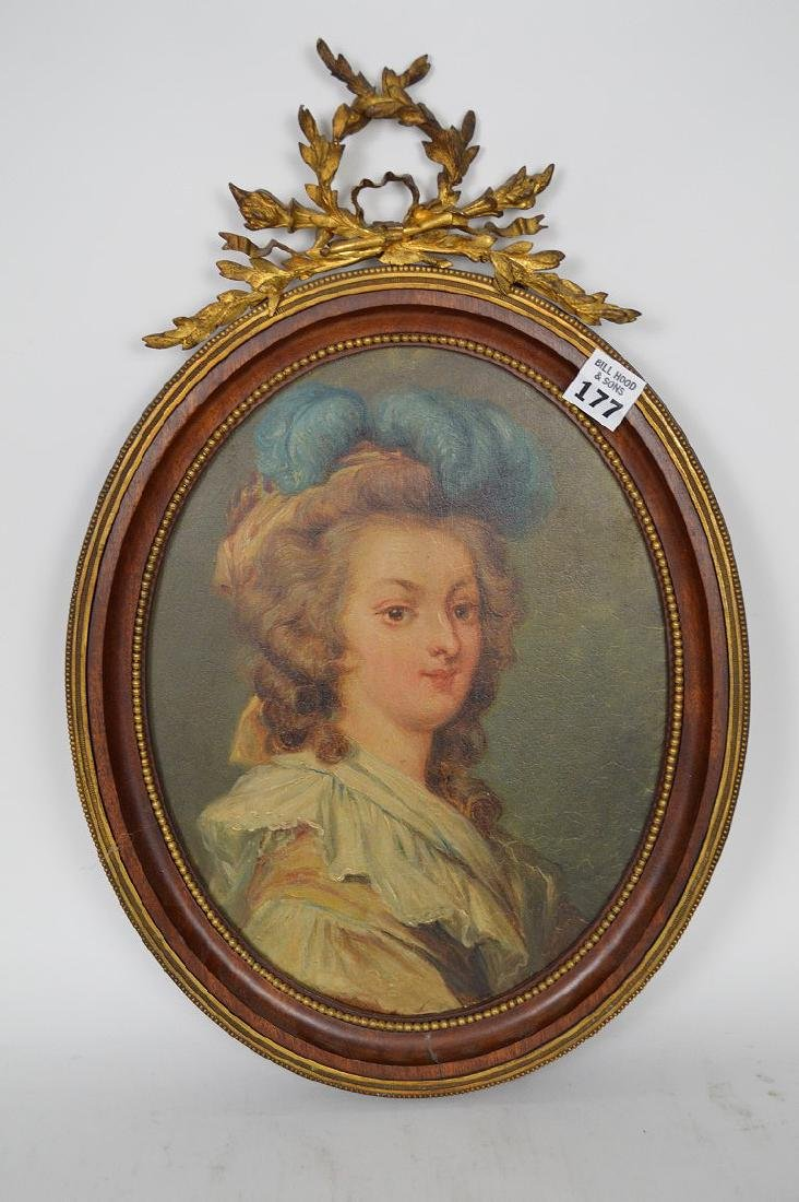Oval portrait on mahogany beaded frame with bronze