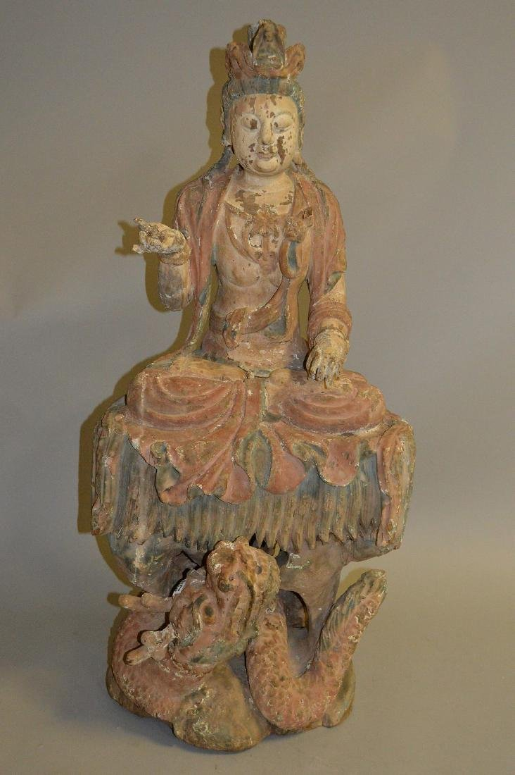 18th Century Chinese carved seated buddha on coiling