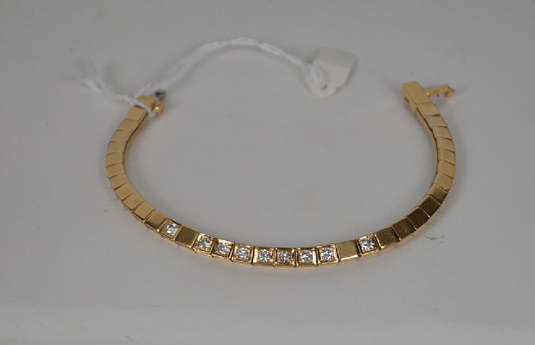 Custom made 14KT YG diamond bracelet. Comprised of 9 - 2