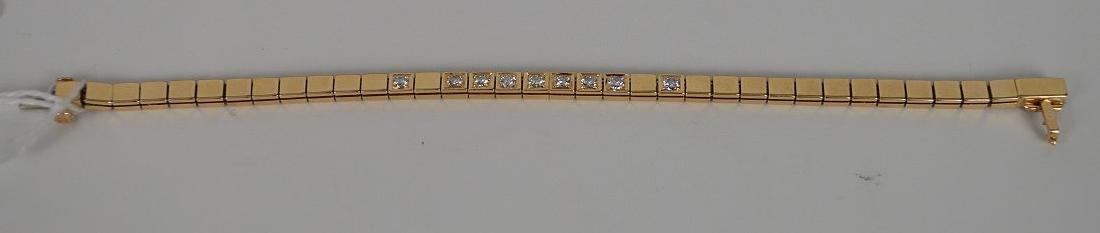 Custom made 14KT YG diamond bracelet. Comprised of 9 - 3