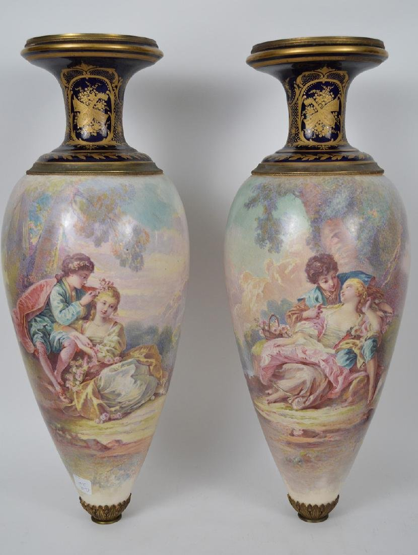 Pair Sevres hand painted Faience urns, signed Maxant,