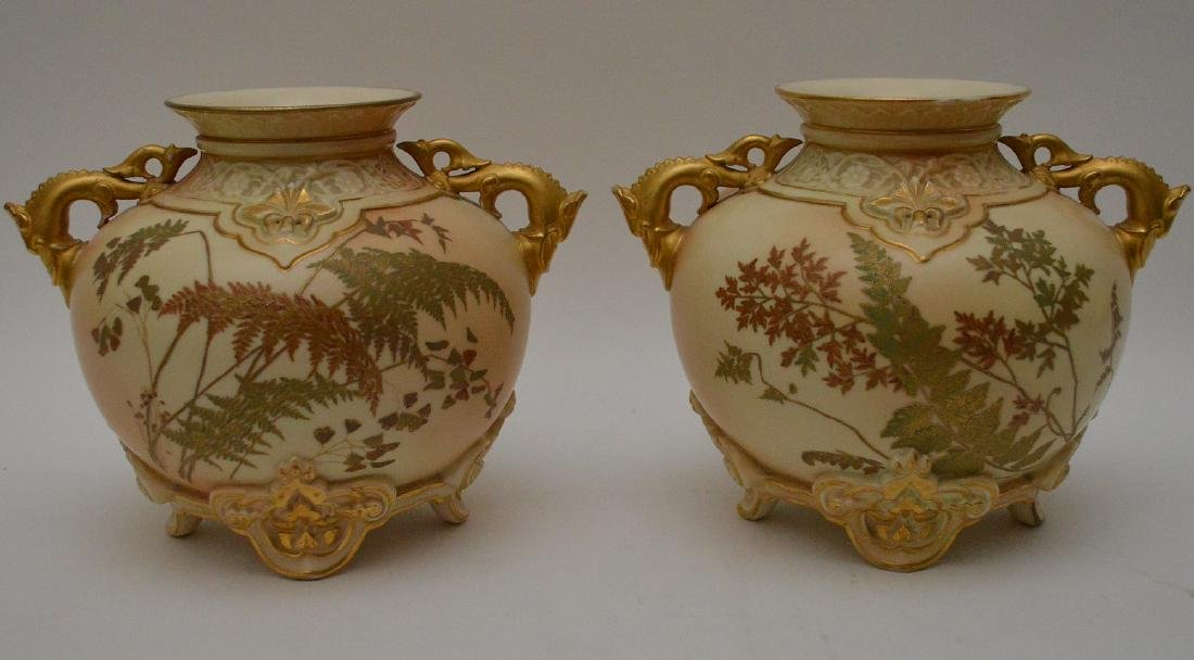 Pair Royal Worcester porcelain footed vases with gilded