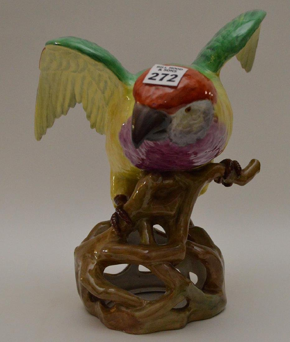 Decorative multi color parrot on tree form base, marked
