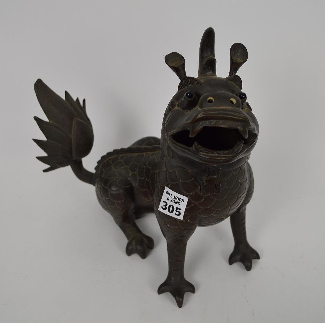Chinese Bronze Foo Dog with glass eyes, head swings