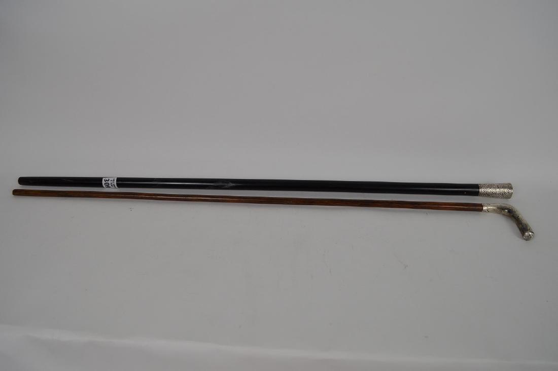 "2 walking sticks with sterling handles, 34""L & 34 1/2""L"