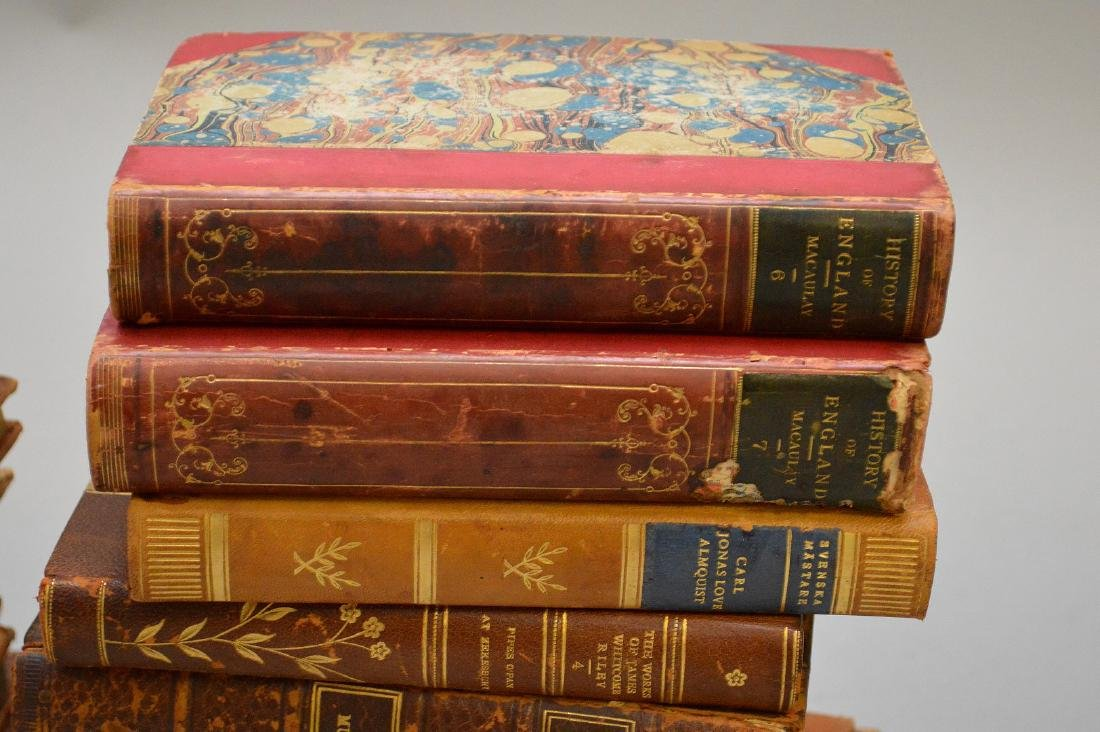 Collection of leather bound books, including 2 early - 5