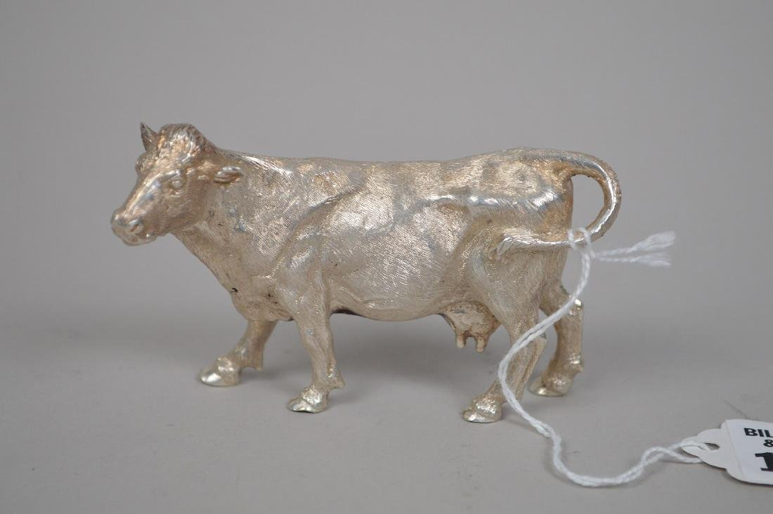 ENGLISH STERLING COW FIGURINE. 2' X 3.5' WEIGHT 5.74