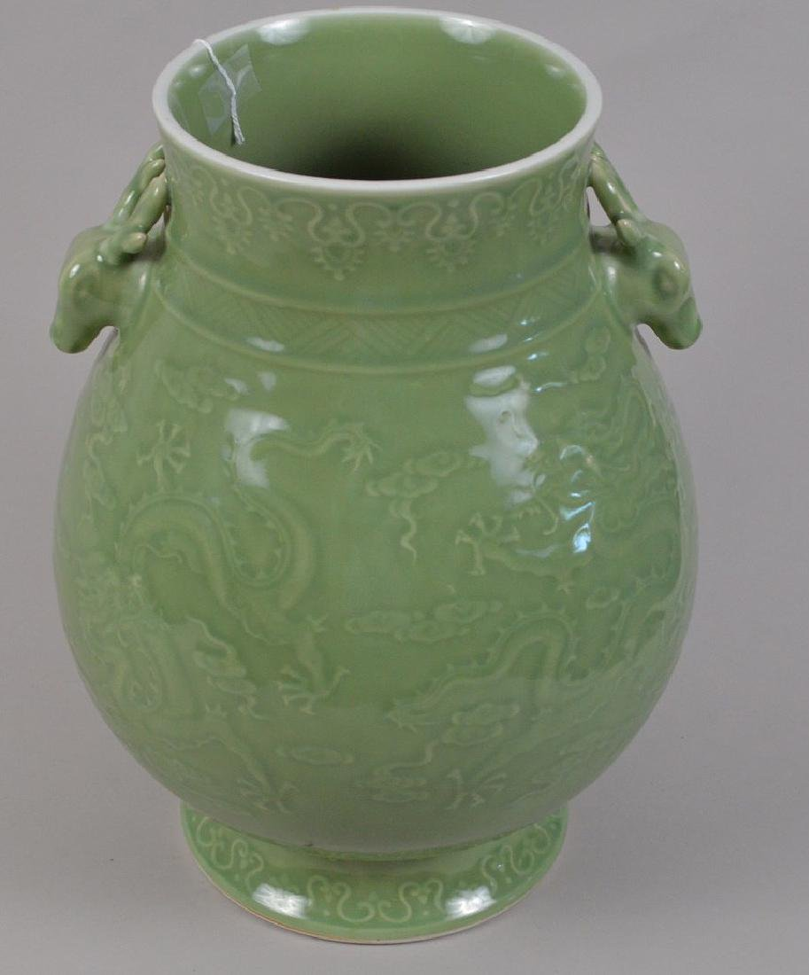 Chinese celadon porcelain vase with figural handles and