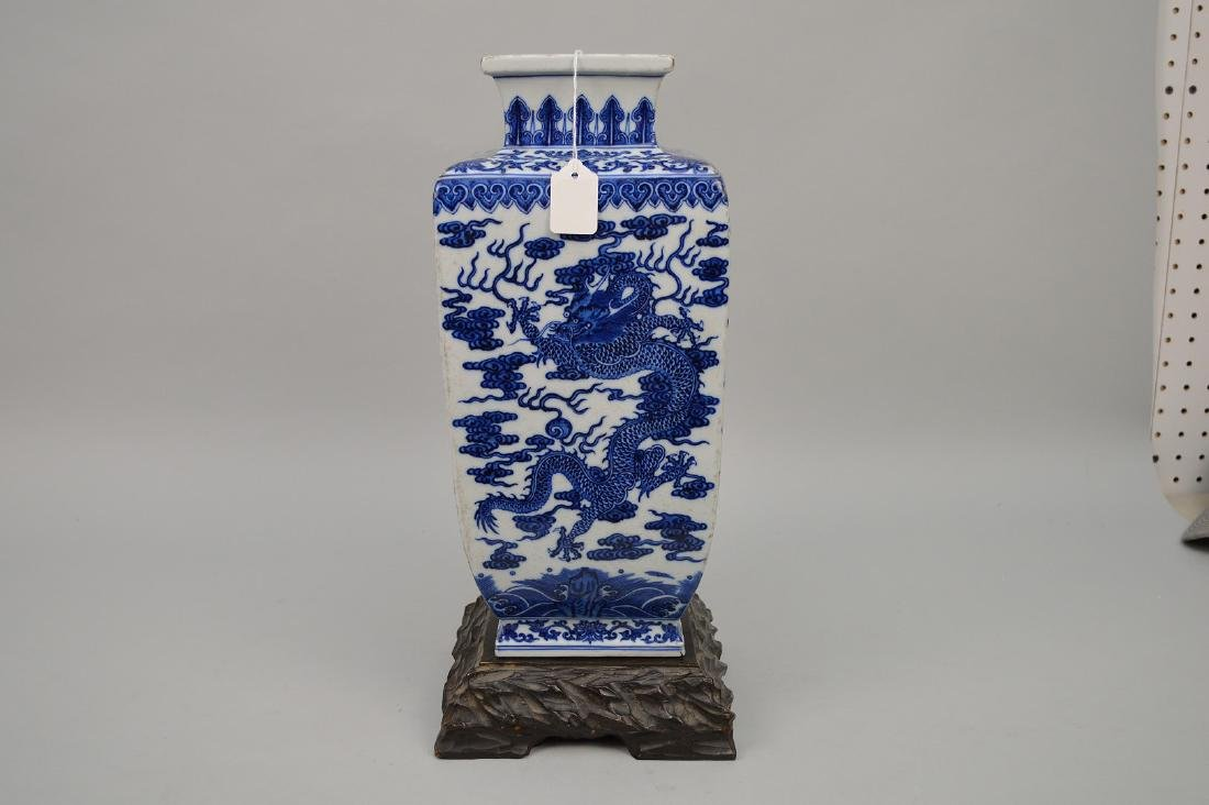 Chinese Blue & White Porcelain Vase with carved wood