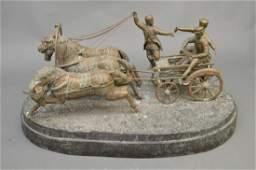 LARGE BRONZE FIGURAL GROUP depicting men on horse drawn