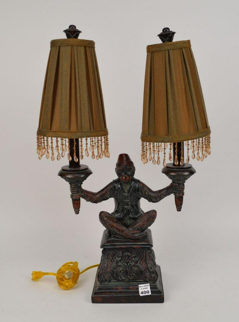 MAITLAND SMITH FIGURAL MONKEY LAMP.  The monkey holding