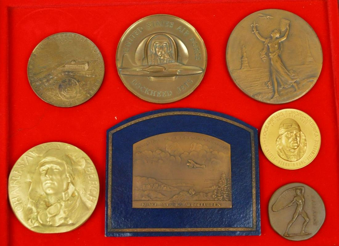 Lot of Seven Aviation Medals to include: (a) Charles