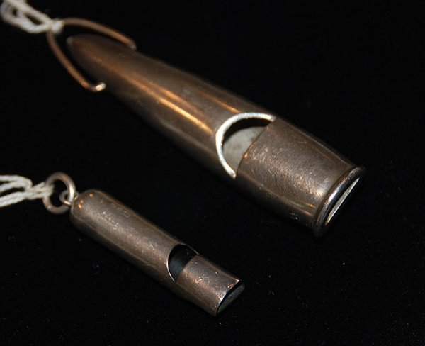 1002: Two English sterling silver whistles, the largest