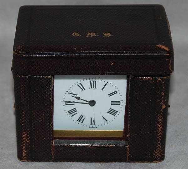 1103: Leather cased French travel clock, circa 1970's,