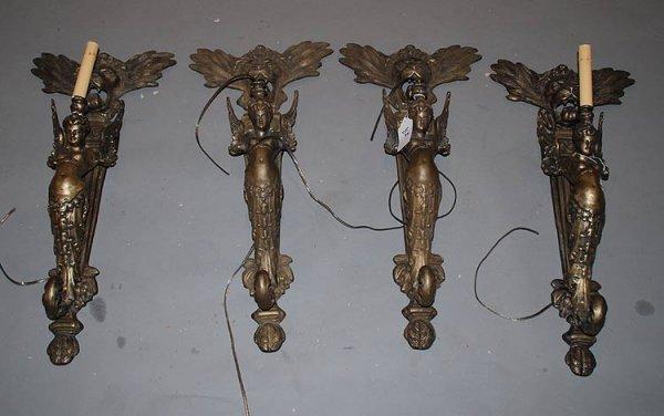 1: 4 matching bronze, single light sconces, a roaring m