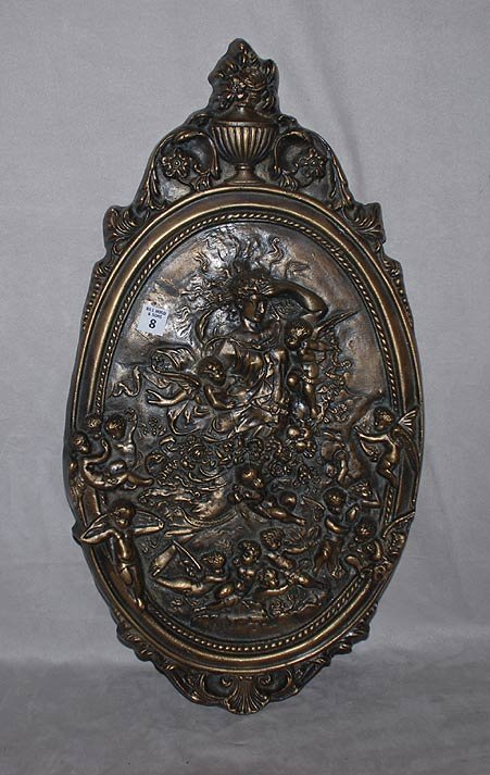 8: Bronze wall plaque depicting multiple putti