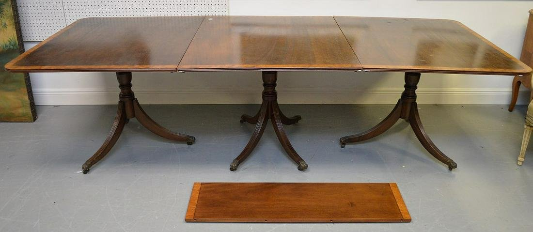 Triple pedestal mahogany banded inlay dining table,