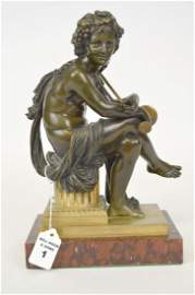 PATINATED & GILT BRONZE BACCHAUS on a red marble base.
