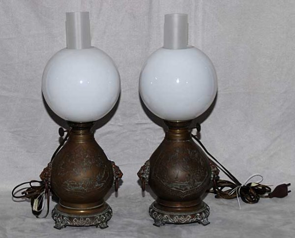 1006: Pair of brass converted oil lamps with lion head