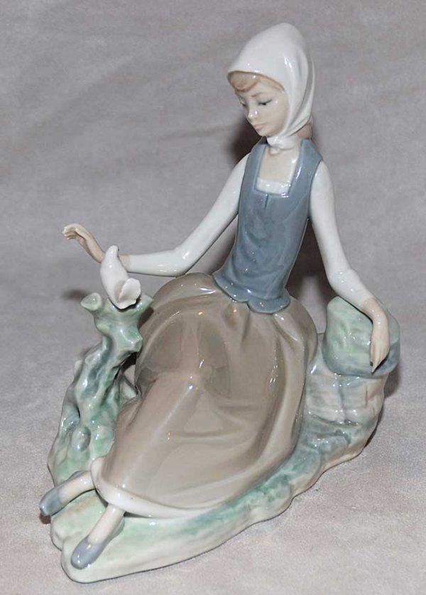 1008: Lladro figurine, seated girl with dove on branch