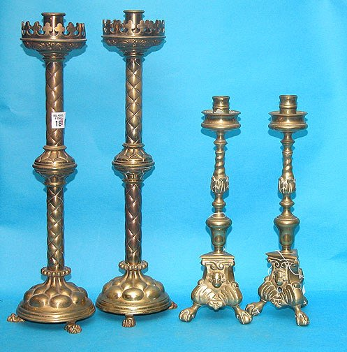 1018: (2) Late sets of highly designed brass footed can