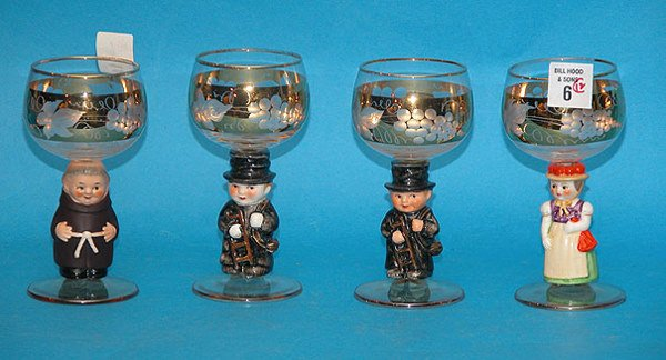 1006: (12) Gilt trim wine glasses with figural stems as