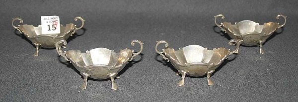 15: 4 sterling footed nut dishes, 8 1/2oz