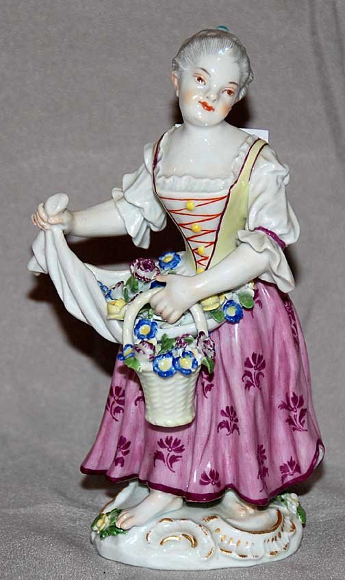 18: Meissen figurine, barefoot lady with flowers and ba