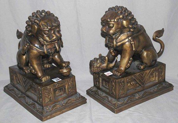 "20: Pair bronze foo dogs, 12""L x 14""h"