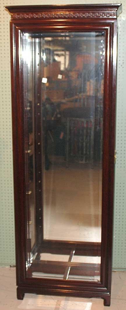 1014: Dark wood beveled glass display cabinet with door